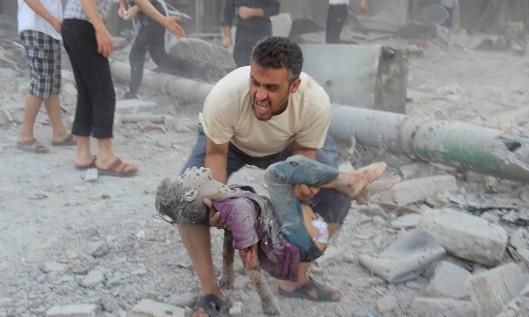 Aleppo-9-luglio-guerra padre bimbo